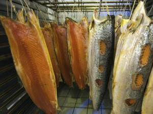 Salmon hang in the the Smokery at H. Forman and Son on Fish Island in east London