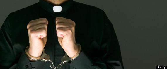 Priest in handcuffs