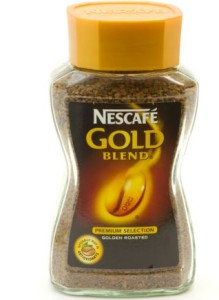 A Glass Jar Of Nescafe Gold Blend Coffee Against a White Background