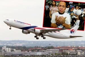 Malezijski-avion-covek-se-moli