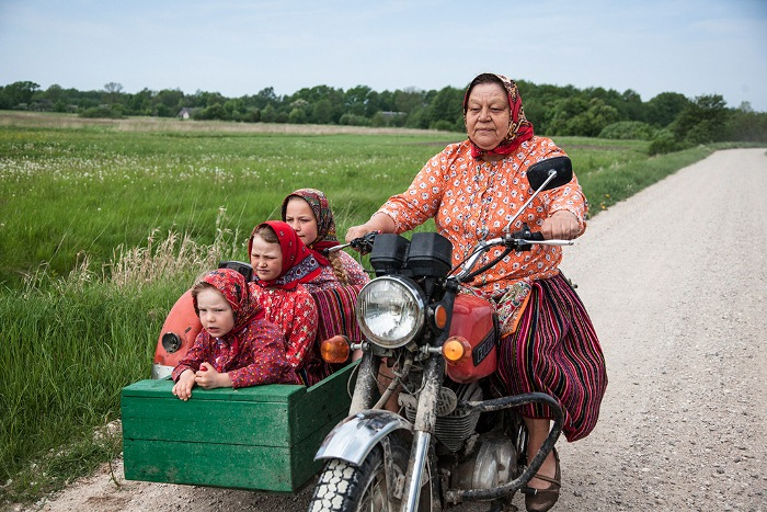 The Matas family rides in an old Ukranian Dnepr sidecar from Soviet times. Many inhabitants use this modified sidecar to travel around the island. Kihnu Island, Estonia - May 2014. (Photo credit: Stefano de Luigi / VII)