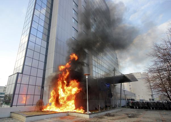 Kosovo government building is set on fire by protesters during clashes in Pristina
