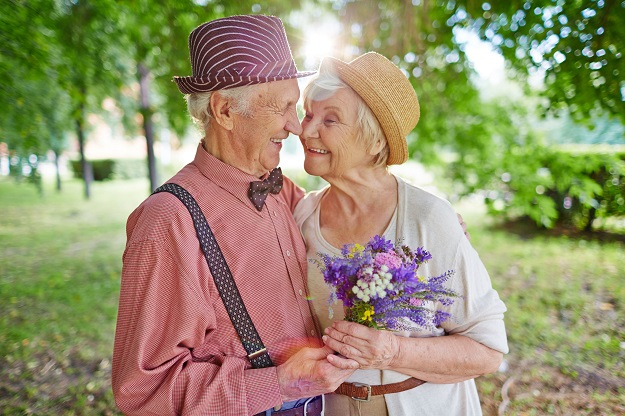 49878339 - happy elderly couple in love enjoying summer day together