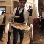 Снимка од потопената Венеција: Келнери во гумени чизми им послужуваат пици на гостите